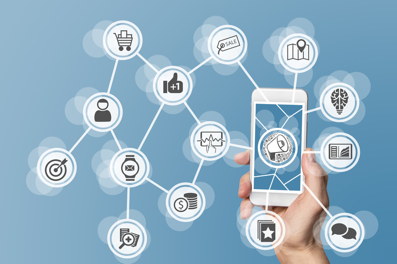 a phone with various social media logos surrounding it