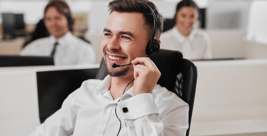 A lead gen specialist on the phone using a headset.